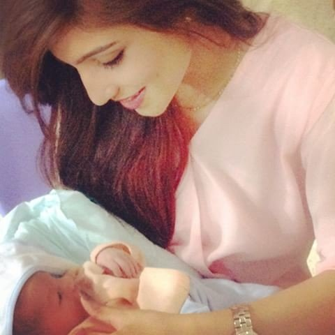 Quratulain Arif with a Baby
