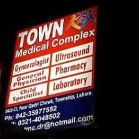 Town Medical Complex - Logo