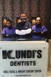 Kundi's Dentists logo