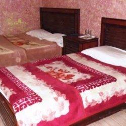 Hotel Kahkashan Triple Bedroom